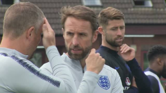 Exterior shots of England Manager Gareth Southgate speaking to England players during a training session at The West Riding County Football...