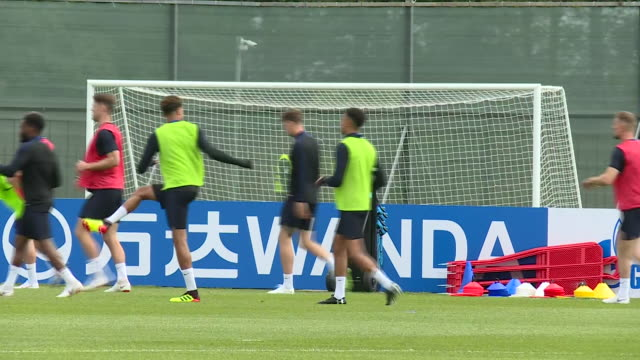 exterior shots of england players warming up on the training pitch including harry kane gareth southgate watching alexander arnold fabian delph and... - world championship stock videos & royalty-free footage