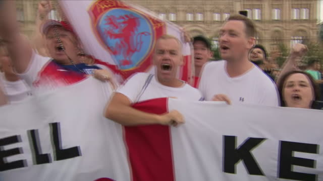 exterior shots of english world cup fans in the centre of moscow with large england fans cheering and waving ahead of the knockout stage match... - fifa world cup stock videos & royalty-free footage