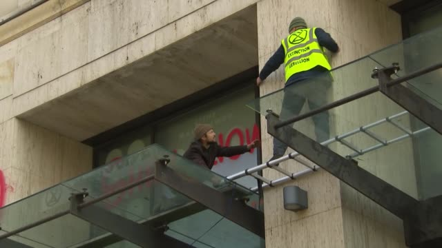exterior shots of environmental activists staging a sit-in at shell's london headquarters during an 'extinction rebellion' protest with protesters on... - campaigner stock videos & royalty-free footage