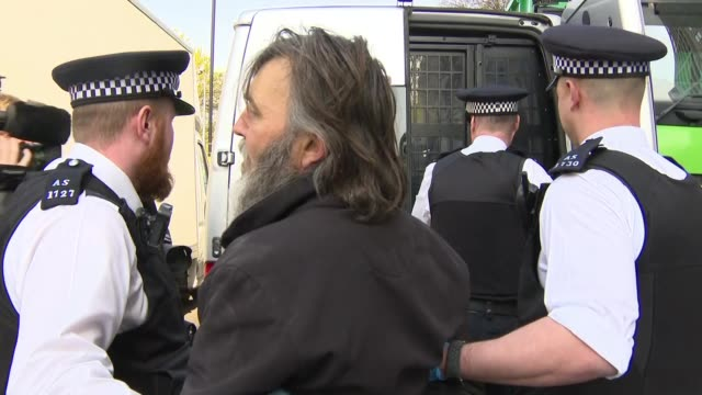 exterior shots of environmental activists staging a sitin at shell's london headquarters during an 'extinction rebellion' protest as police arrest... - arrest stock videos & royalty-free footage