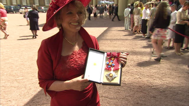vídeos y material grabado en eventos de stock de exterior shots of esther rantzen posing with her insignia badge and star after being appointed as dame commander of the british empire >> on june 25... - insignia accesorio personal