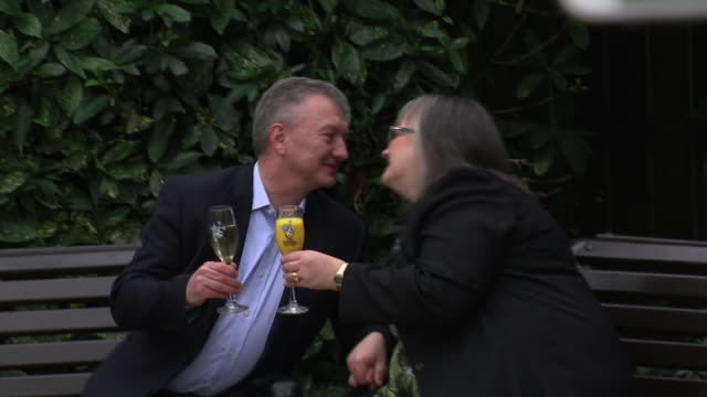 exterior shots of euromillions lottery winners frances and patrick connelly from county armagh sipping champagne and posing for the media on 4... - county armagh stock videos & royalty-free footage