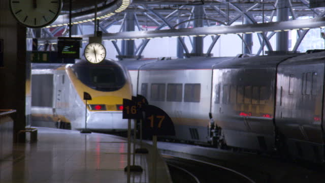 exterior shots of eurostar trains and passengers at brussels midi station on march 04, 2010 in brussels, belgium. - brussels capital region stock videos & royalty-free footage