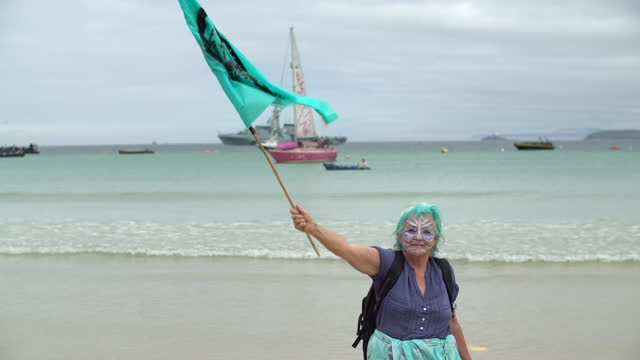 exterior shots of extinction rebellion climate change protesters sailing at sea on pink boat on 11th june 2021 st ives, united kingdom. - pink colour stock videos & royalty-free footage
