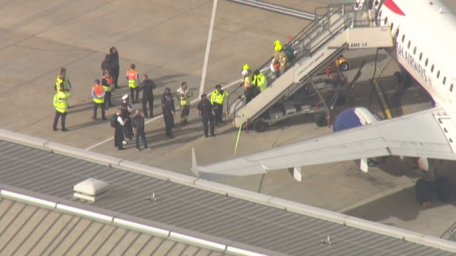 exterior shots of extinction rebellion protesters being removed from the roof of an airplane at london city airport on 10 october 2019 - waiting stock videos & royalty-free footage