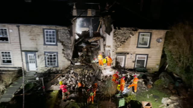 exterior shots of extremley damaged terraced house reduced to rubble after explosion and emergency workers searching through the debris on the 18th... - misfortune stock videos & royalty-free footage