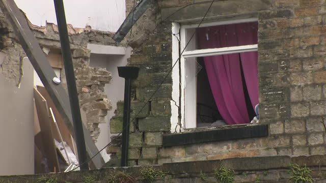 exterior shots of extremley damaged terraced house reduced to rubble after explosion and emergency workers at the scene on the 18th february 2021 in... - misfortune stock videos & royalty-free footage