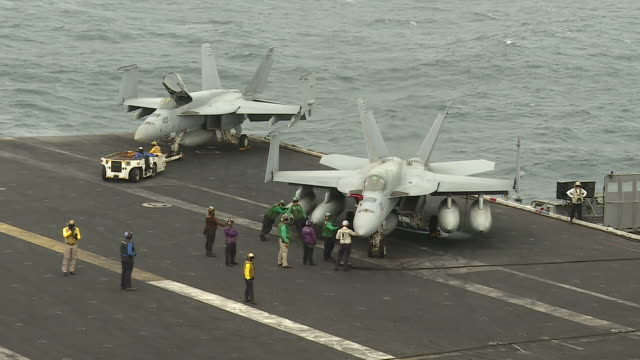 exterior shots of f-18 fighter jets on the flight deck of the uss abraham lincoln aircraft carrier and the bridge of the ship on 12 august 2019 in... - aircraft carrier stock videos & royalty-free footage