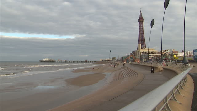 exterior shots of families enjoying the beach and children on guided donkey rides on october 27 2016 in blackpool england - blackpool stock-videos und b-roll-filmmaterial