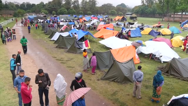 exterior shots of families in tents in a temporary shelter camp after a major earthquake hit the area filmed on april 30 2015 in kathmandu nepal - emergency shelter stock videos & royalty-free footage