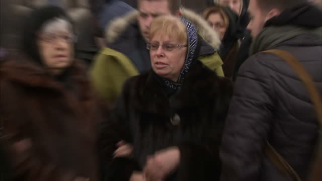 exterior shots of family members of russian ambassador andrei karlov at funeral including his wife marina karlova on december 22 2016 in moscow russia - assassination of andrei karlov stock videos & royalty-free footage