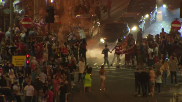 Exterior shots of fans celebrating in streets of city after Liverpool wins 2019 UEFA Champions League final on 01 June 2019 in Liverpool United...