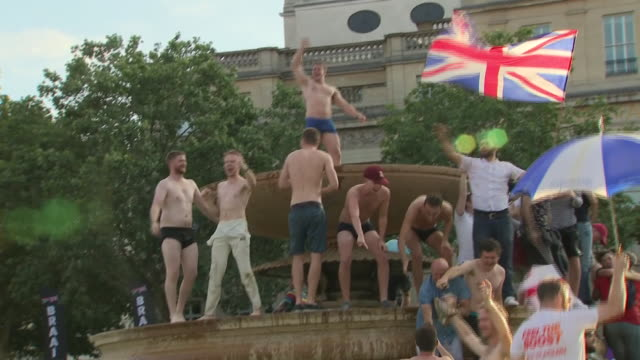 exterior shots of fans celebration england winning the cricket world cup 2019 from the trafalgar square fan zone on 14th july 2019 in london england - happiness stock videos & royalty-free footage