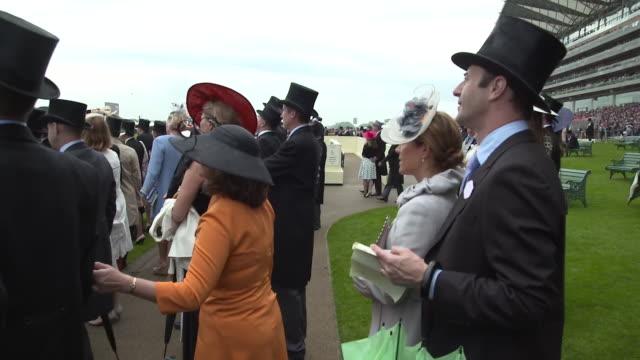 exterior shots of fans looking at betting slips at royal ascot shot on 19 june 2019 berkshire england - horse racing stock videos & royalty-free footage