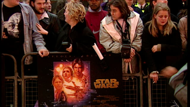 exterior shots of fans queuing up for the premiere of star wars special edition at leicester square on march 20 1997 in london england - star wars stock videos & royalty-free footage
