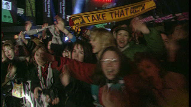 exterior shots of fans screaming and chanting take that outside earls court exhibition centre and waiting for celebrities to arrive for the brit... - 1996 stock videos and b-roll footage