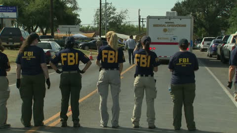exterior shots of fbi personnel examining the road outside the first baptist church of sutherland springs, where 26 people were killed when gunman... - fbi stock-videos und b-roll-filmmaterial