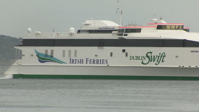 exterior shots of ferries and container ships sailing into and out of dublin port on 29 july 2017 in dublin, ireland - film container stock videos & royalty-free footage