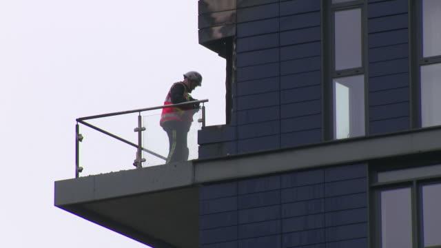 GBR: Fire crews tackle a blaze at a block of flats in Wembley
