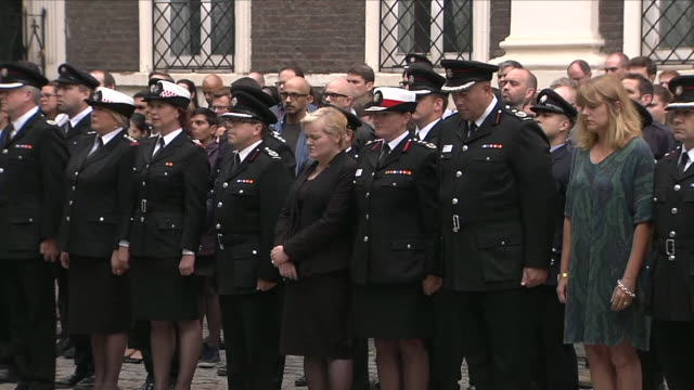 exterior shots of firefighters at the london fire brigade hq, including dany cotton stood and observing a 72 second silence to commemorate the... - トリビュート・イベント点の映像素材/bロール