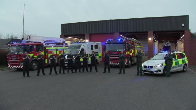 exterior shots of firemen and emergency services staff clapping in support of nhs and key workers during the covid-19 outbreak on 9 april 2020 in... - sadness stock videos & royalty-free footage