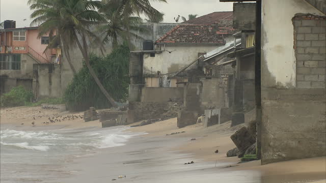 exterior shots of fishermen and their boats on a beach in the village of katugoda sri lanka an area very badly hit by the boxing day 2004 tsunami on... - 2004 indian ocean earthquake and tsunami stock videos & royalty-free footage