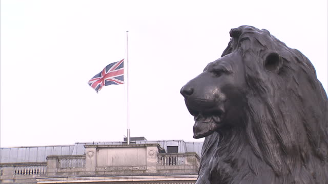 exterior shots of flags flying at halfmast from the national gallery and from the rooftops of buildings seen from horse guards parade on march 23... - horse guards parade stock videos and b-roll footage