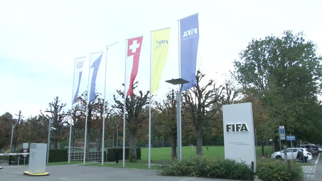 exterior shots of flags flying outside fifa headquarters. >> on september 29, 2015 in zurich, switzerland. - fifa stock videos & royalty-free footage