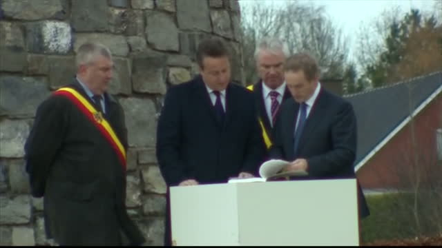 exterior shots of flanders fields and british prime minister david cameron visiting the island of ireland peace park memorial at messines with irish... - 戦争記念碑点の映像素材/bロール