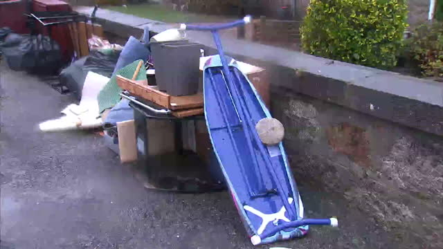 vídeos de stock e filmes b-roll de exterior shots of flood damaged furniture and other items stacked outside homes in ballater and a car with water weeds caught in its front grille... - grade de radiador