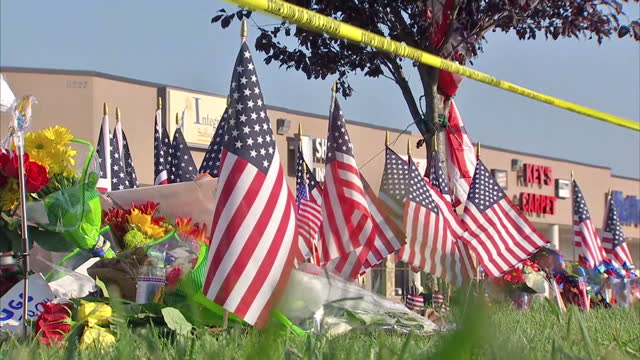 Exterior shots of floral tribute and flags left at seen of shooting after Muhammad Youssef Abdulazeez opened fire at an Army recruitment building on...