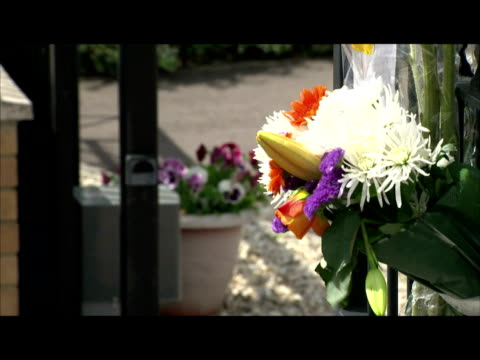 exterior shots of floral tributes and messages left next to the auotmatic electric gate where karolina golabek died the five year old was playing at... - cumbria stock-videos und b-roll-filmmaterial
