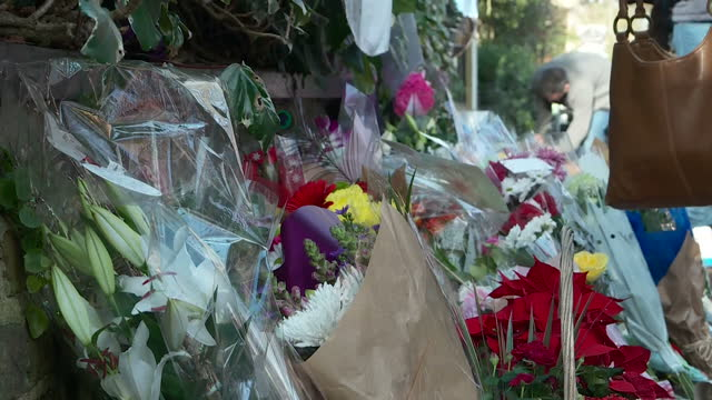 exterior shots of floral tributes and mourners crying outside of george michael's house in highgate on december 27, 2016 in london, england. - mourner stock videos & royalty-free footage