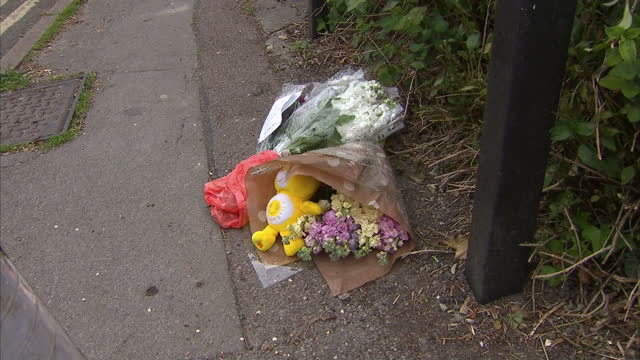 Exterior shots of floral tributes and notes of sympathy at Vicarage Road the scene of the murders of three members of the same family on May 24 2015...