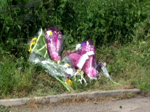 exterior shots of floral tributes and sympathy notes left at town end farm where james and jennifer jackson where killed by derrick bird - jackson stock videos & royalty-free footage