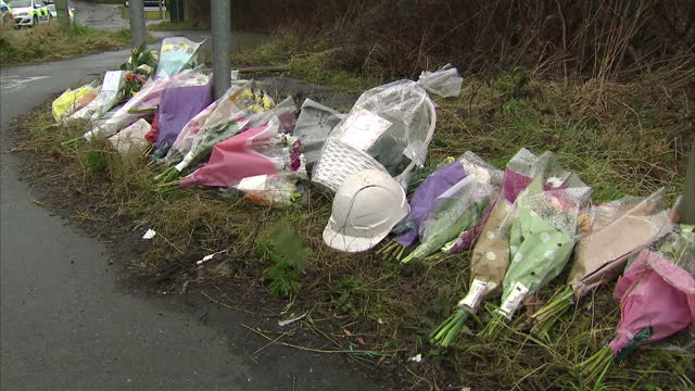 exterior shots of floral tributes left for victims of didcot power station collapse on march 01 2016 in didcot england the boss of the firm... - didcot stock videos and b-roll footage