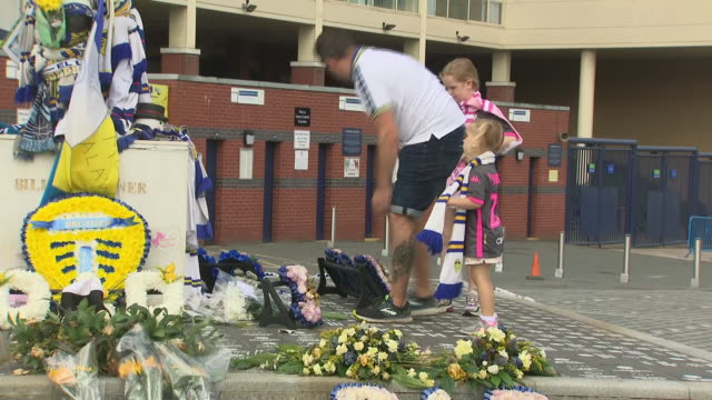exterior shots of floral tributes scarves and flags in memory of the late jack charlton outside elland road leeds united fc stadium as fans pay their... - jack charlton stock videos & royalty-free footage