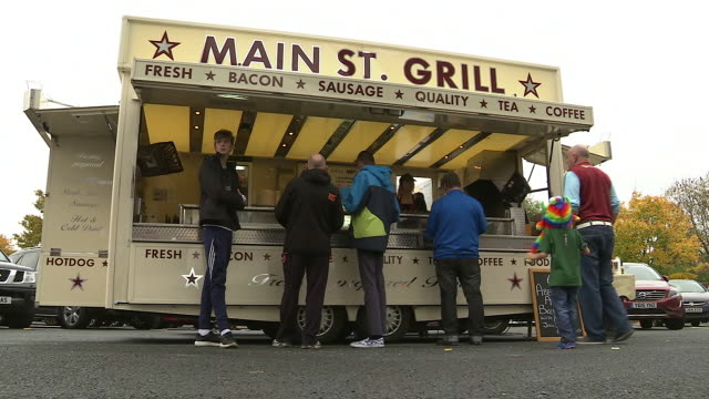 exterior shots of food at a fast food van being prepared outside burnley fc's turf moor stadium on game day on 31st october 2015 in burnley england - hot dog stock videos & royalty-free footage
