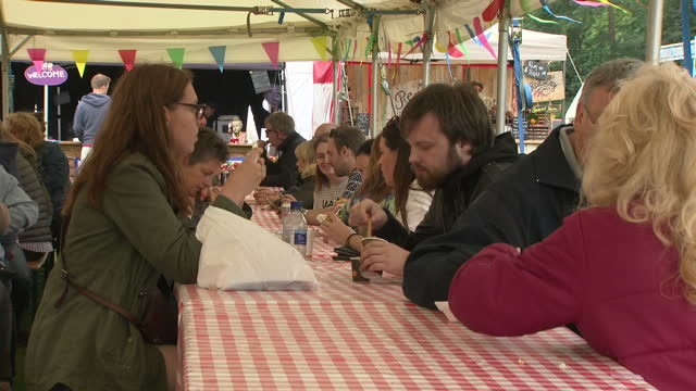 exterior shots of food lovers sampling various fare at a food festival on 23 june 2017 in birmingham united kingdom - fare video stock e b–roll
