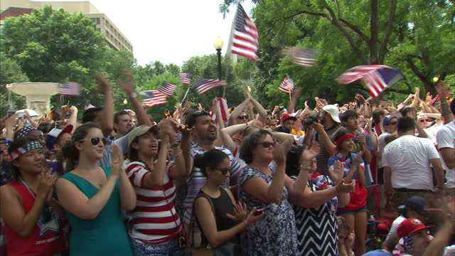 exterior shots of football fans in a washington dc park watching the usa v germany world cup clash looking nervous and cheering with stars and... - internationaler fußball stock-videos und b-roll-filmmaterial
