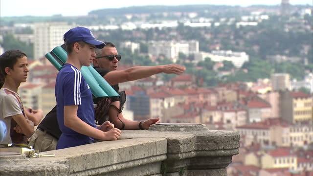 vídeos de stock, filmes e b-roll de exterior shots of football fans looking out over lyon during the euro 2016 championships on july 05 2016 in lyon france - olympique lyonnais