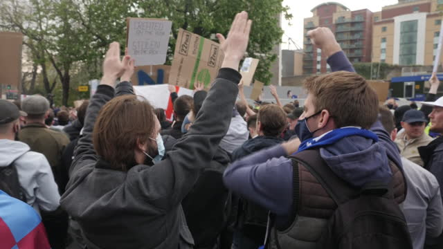 exterior shots of football fans protesting plans for european super league and holding banners and placards outside stamford bridge football stadium... - europe stock videos & royalty-free footage