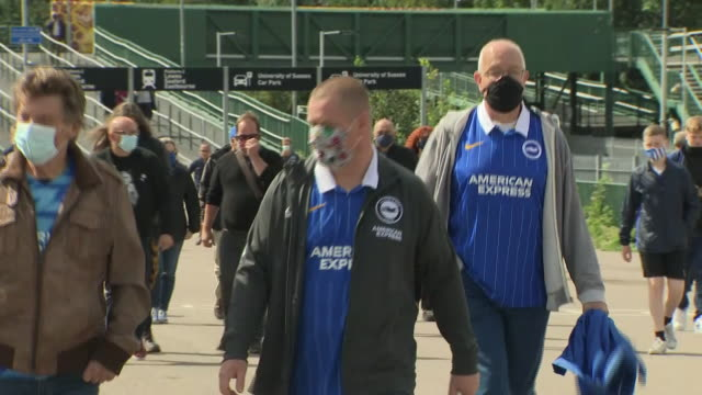 exterior shots of football fans walking towards stadium to attend football game with face masks on on 9 september 2020 in brighton, united kingdom - competition stock videos & royalty-free footage