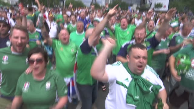 Exterior shots of football fans wearing Northern Ireland shirts and Germany shirts walking through the streets in crowds ahead of the Euro 2016...