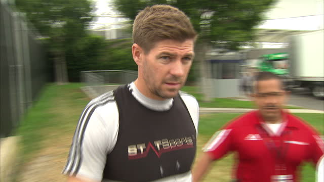 Exterior shots of footballer Steven Gerrard signing autographs for fans at an LA Galaxy training session on July 07 2015 in Los Angeles California