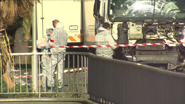 exterior shots of forensic officers and police next to the wrecked lorry used in the nice terror attacks. shot on july 15, 2016 in nice, france. - terrorism stock videos & royalty-free footage