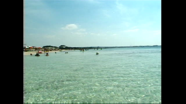 Exterior shots of Formentera beach front as seen from pedalo sunbathers and anchored boats and yachts at sea on 30 June 2017 in Ibiza Spain