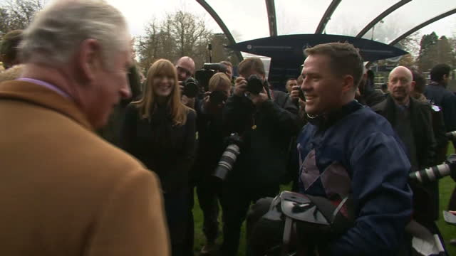 Exterior shots of former England international footballer Michael Owen speaking to racing owners trainers and supporters including Prince Charles...