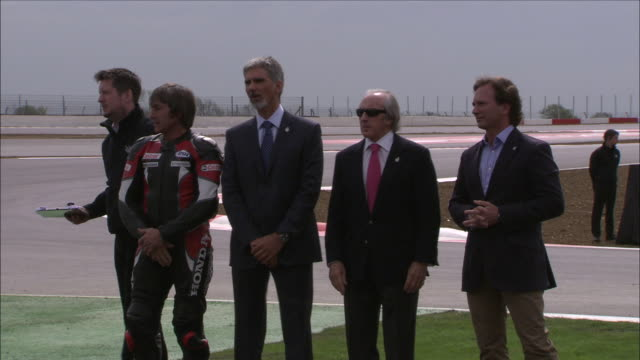 exterior shots of former f1 driver damon hill with jackie sewart, christian horner, prince andrew, david coulthard and mark webber launching an event... - christian horner stock videos & royalty-free footage